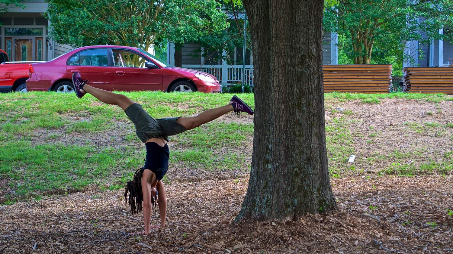 Gymnastics under a tree at the Atlanta Beltline