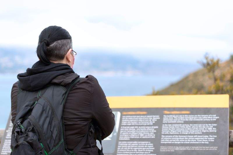 person reading signage at national park