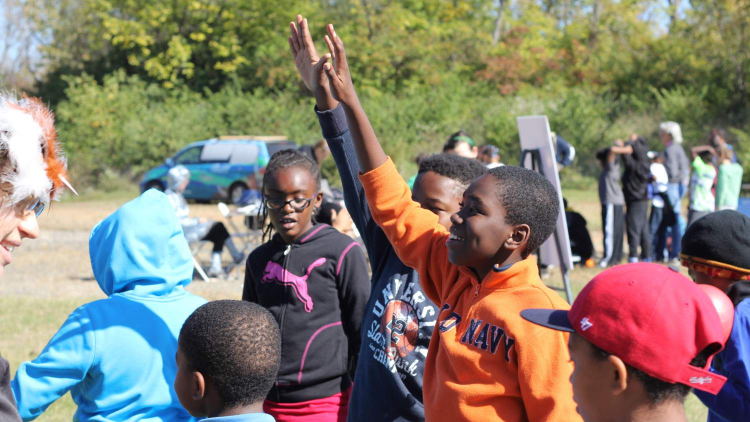 Kids raising their hands at Debris Day