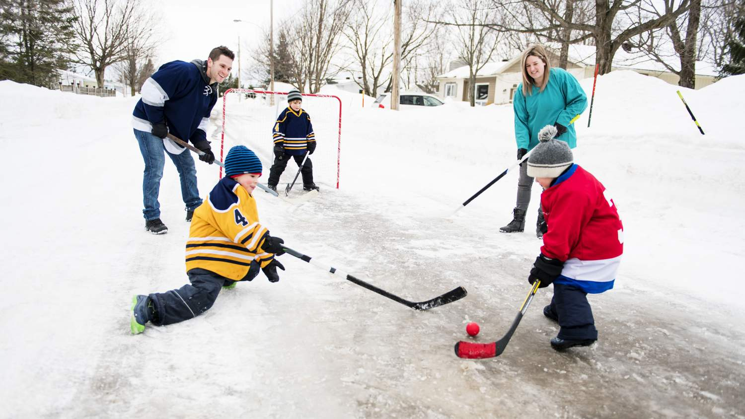 Family playing hockey