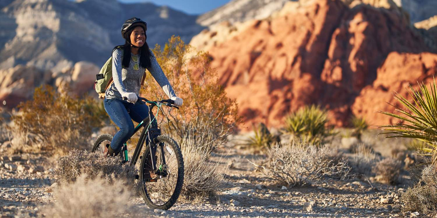 Young woman riding her bike in Red Rock Canyon