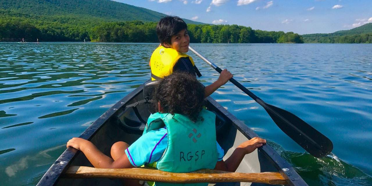 Kids rowing a boat