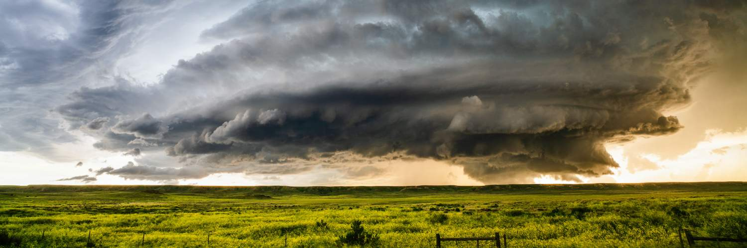 ominous weather cloud over a field
