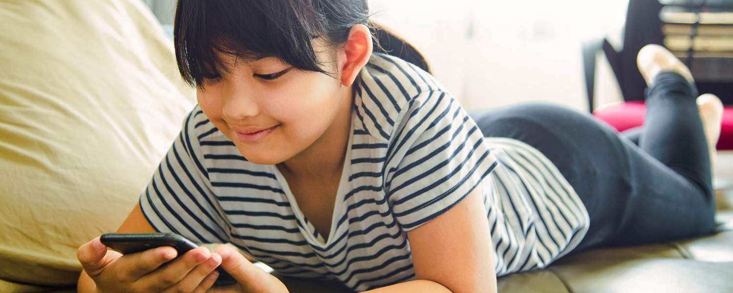 Young girl looking at a cell phone