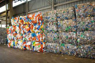 Bales of plastic waste at a recycling facility