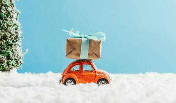 Toy car driving with a gift