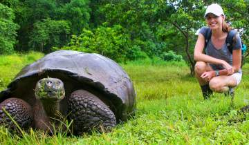 Woman posing with a turtle