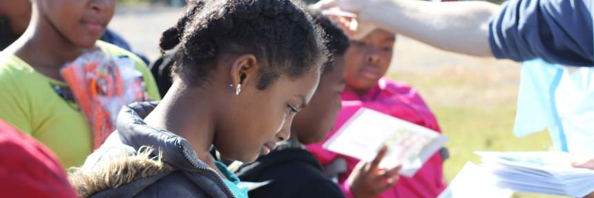 Girl reading at Debris Day 2015