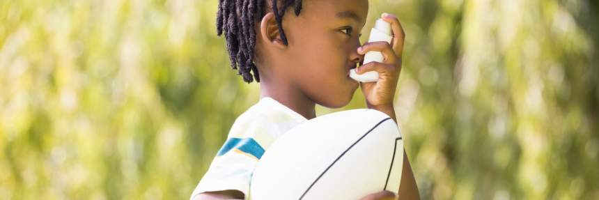 Child using an inhaler outdoors