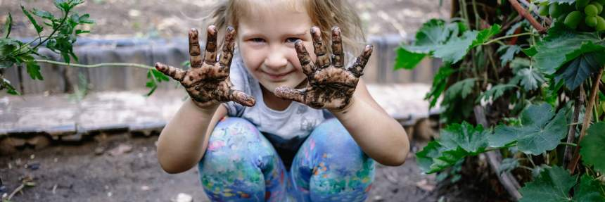 Girl in a garden in the mud