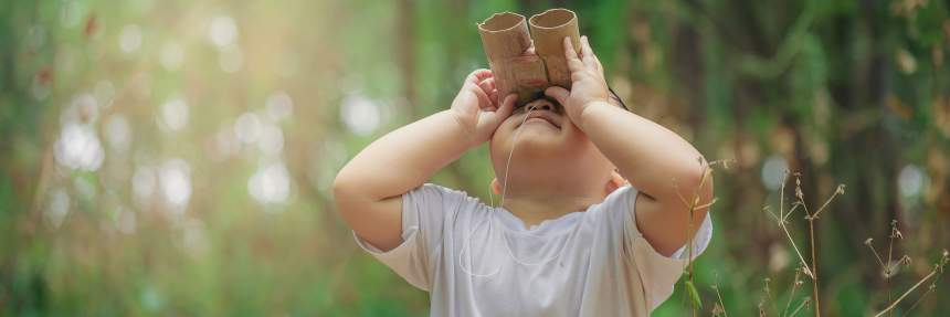 Kid with cardboard binoculars