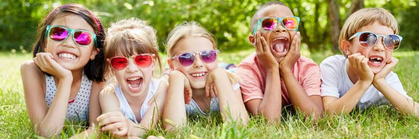 Kids on the lawn with sunglasses