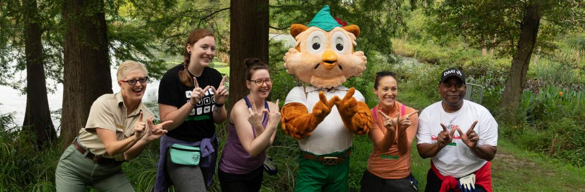 Woodsy Owl and volunteers at Kenilworth Aquatic Gardens
