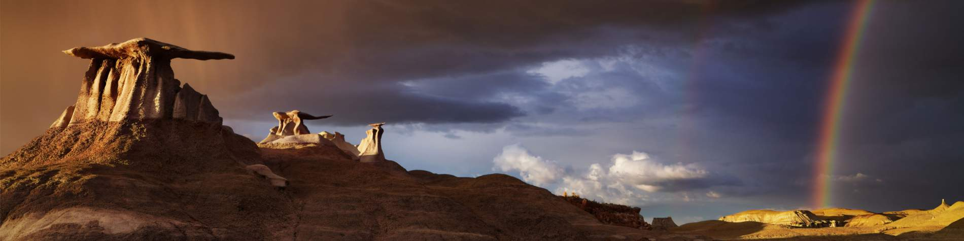Storm and rainbow at Bisti Badlands in New Mexico