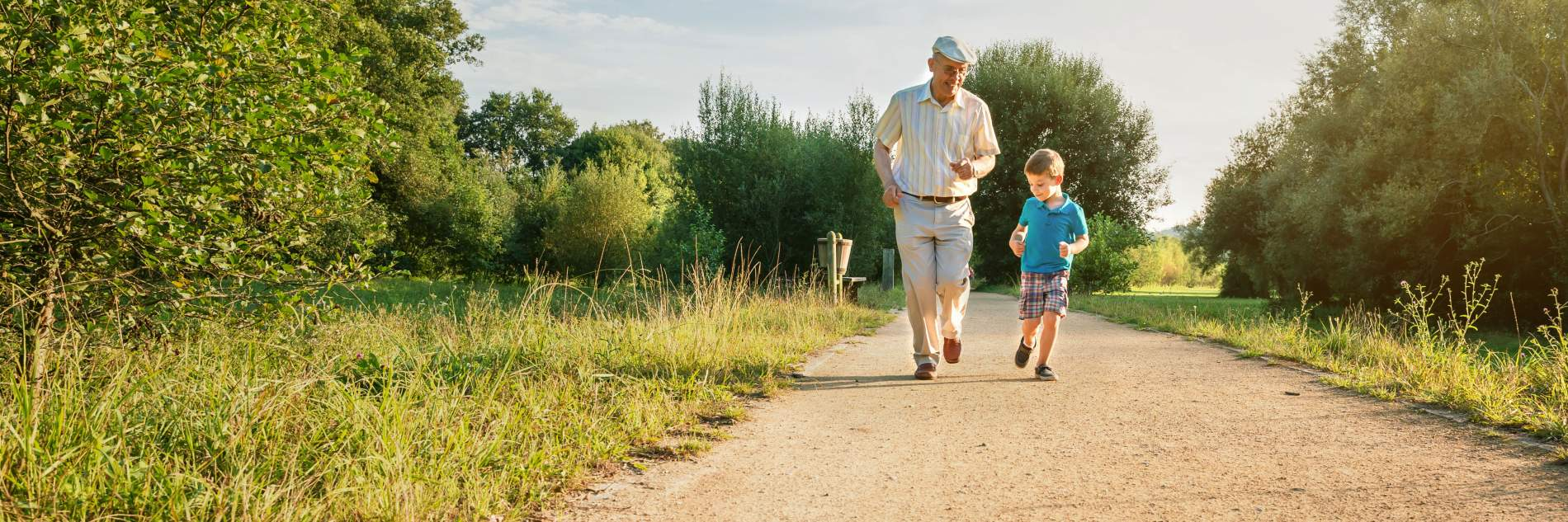 Grandfather and grandson running