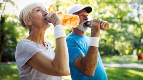 Older people hydrating at the park