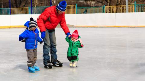 Dad skating with his kids