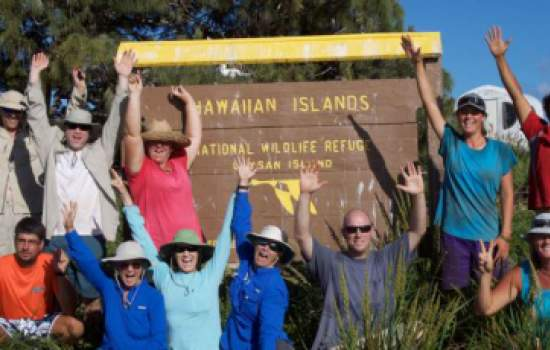 Millerbird team on Laysan Island. (back row/ left to right) Peter Luscomb, Dr. Thierry Work, Chris Farmer,Michele Kuter, Claudia Mischler, Tawn Speetjens, Amy Munes. (front row kneeling/left to right) Robby Kohley, Sheila Conant, Sheldon Plentovich
